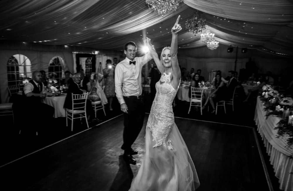 Newlyweds having fun on the dance floor.